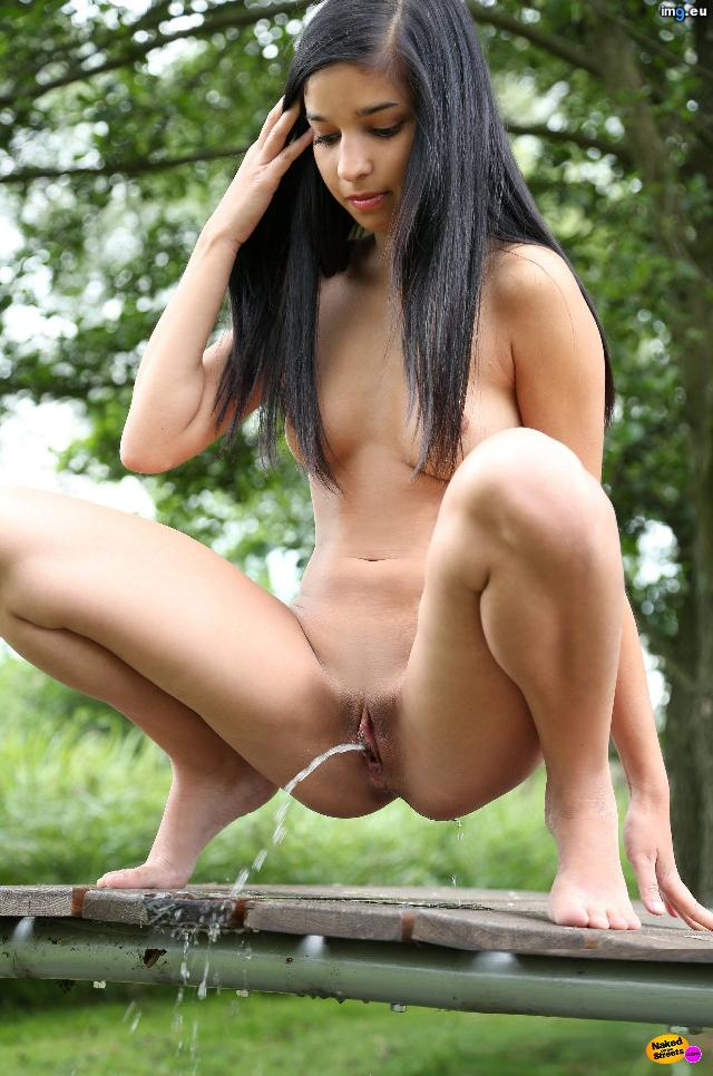 Cute young girl pissing outdoor